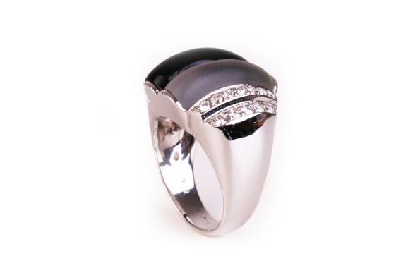golden ring with rock crystal and onyx